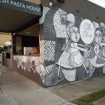 SUBURBAN CAFE; MURAL INVCORPORATING LOGO & COLOUR SCHEME OF BUISINESS BRANDING